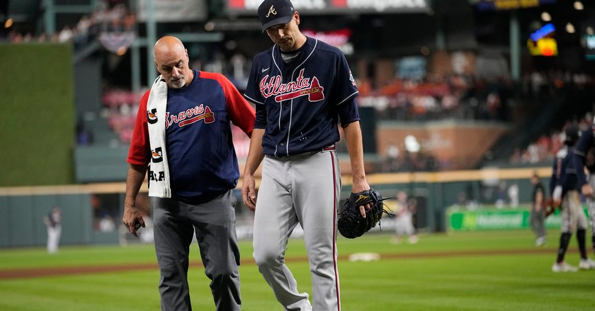 Atlanta Braves starting pitcher Charlie Morton is helped off the field during the third inning of Game 1 in baseball's World Series between the Houston Astros and the Atlanta Braves Tuesday, Oct. 26, 2021, in Houston. (AP Photo/Ashley Landis)