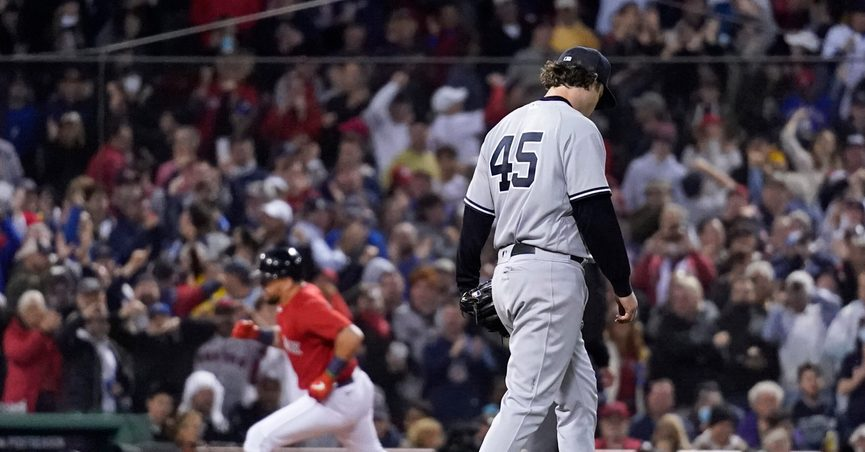 New York Yankees starting pitcher Gerrit Cole (45) reacts as Boston Red Sox's Kyle Schwarber rounds third base after hitting a solo homer in the third inning of an American League Wild Card playoff baseball game at Fenway Park, Tuesday, Oct. 5, 2021, in Boston. (AP Photo/Charles Krupa)